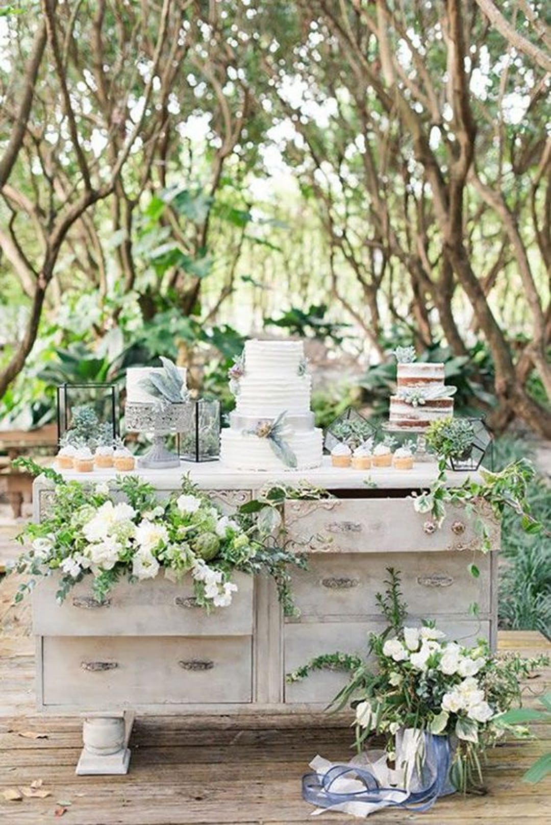 Gorgeous cake table at an outdoor wedding